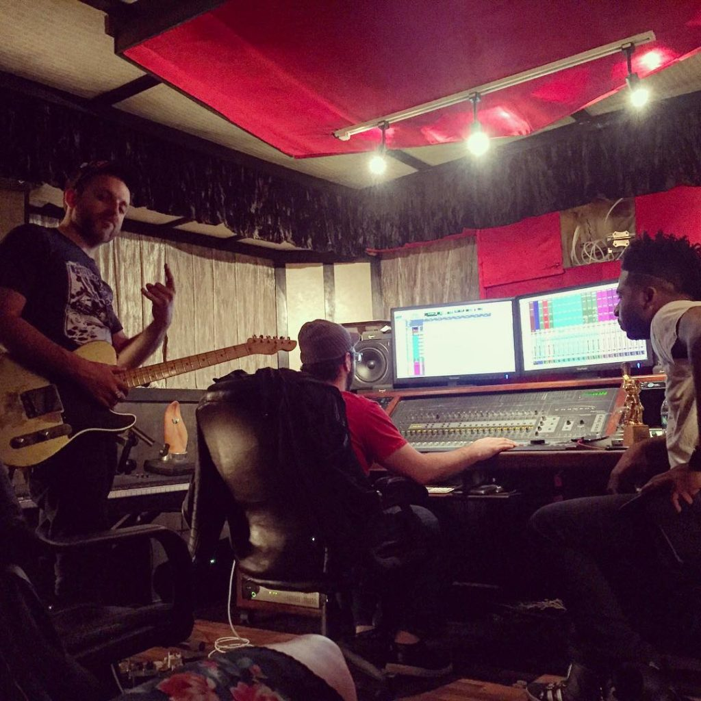 Jimmy Foon and Shayon Daniels mixing sound and score at their Jenga Productions studio.